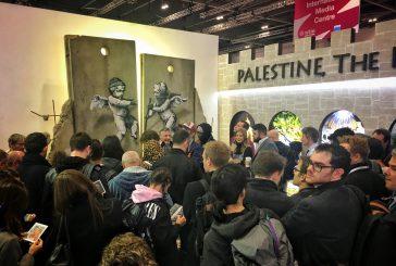 Opera di Banksy spopola al Wtm di Londra nello stand della Palestina
